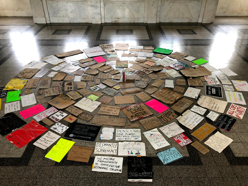 Protest signs used to protest monument